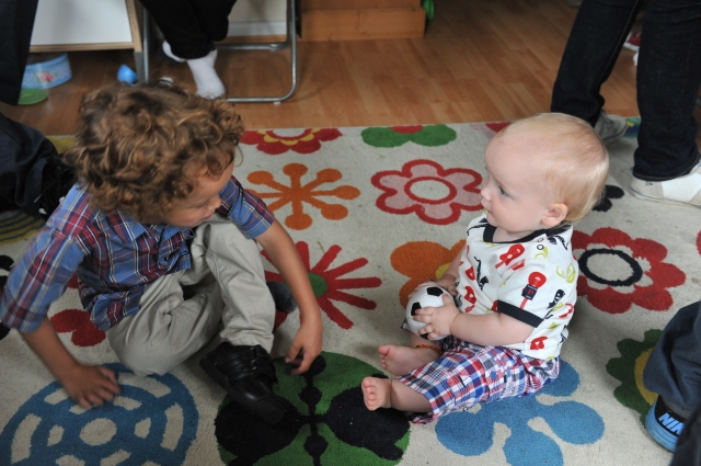 Playing with his big cousin Evan