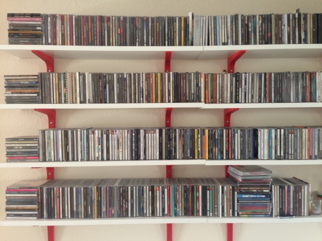Some of Chris's many CDs. I love these shelves. Not sure quite how we'll make the wall 'good' when we move out though. oops.